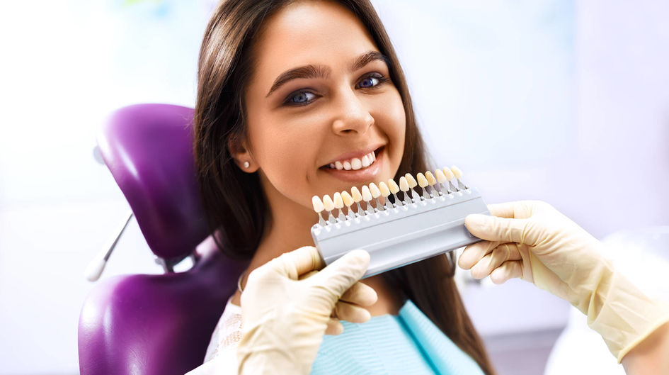 Smiling woman with artificial teeth